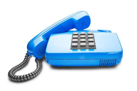 handset lies on the blue landline phone Stock Photo