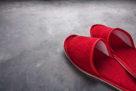 red slippers on the concrete floor
