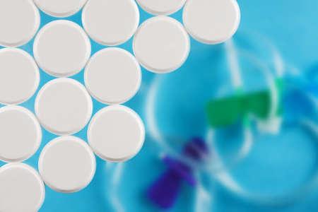 Modern white medical pills on medical background