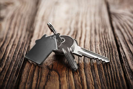 Real estate concept, Key ring and keys on wooden background