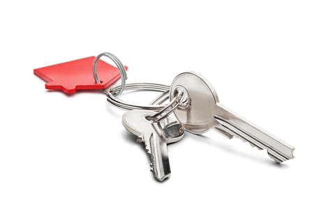 Estate concept, red key ring  and keys on isolated background Stock Photo