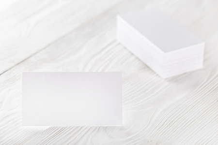 blank business cards on wooden background. Place for ID.