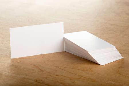 Blank business cards on a wooden surface Reklamní fotografie
