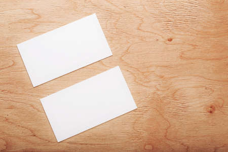 Blank business cards on wooden surface. Concepte of business