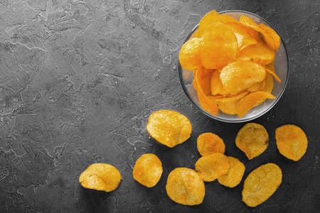 Crispy potato chips in on old kitchen table fastfood concepte