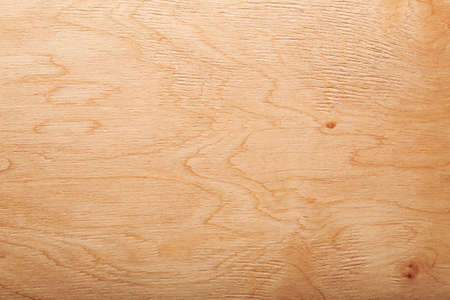 Wooden brown background with a vivid texture.