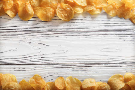 chips potatoes on light old wooden background.concept of fast food and snacks Stockfoto