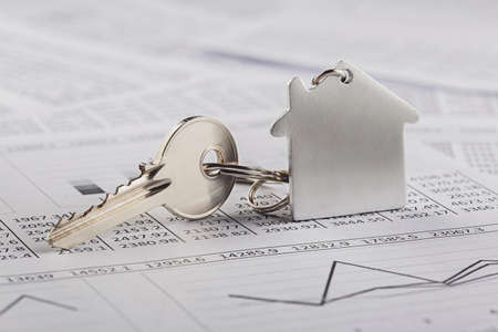 Real estate, keychain with house symbol. Key with finance blank.