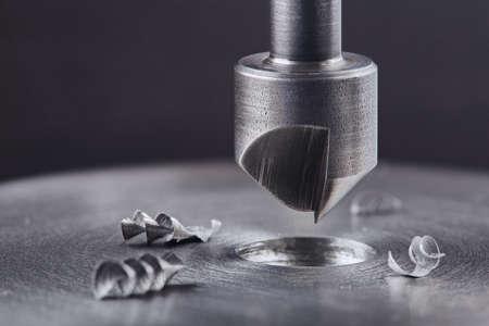 Countersink drill bit make sink in hole in steel billet. Locksmith work.