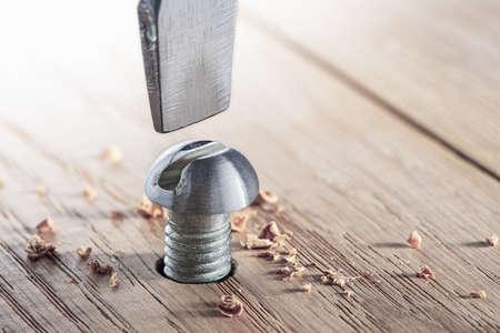 screwdriver screw bolt in a wood oaks plank