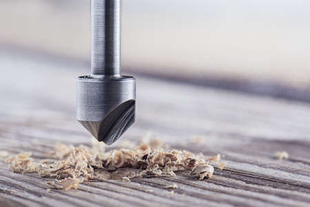 Countersink drill bit make sink in hole for screw in wooden plank