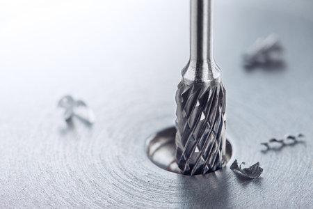 end mill bit cutting big hole in a steel billet