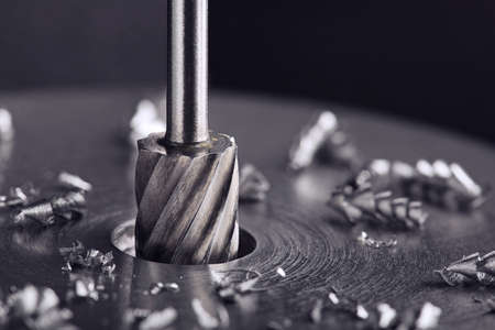 Milling cutter make sink in hole in steel billet. Locksmith work.