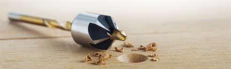 Countersink drill bit make sink in hole for screw in wooden oak plank