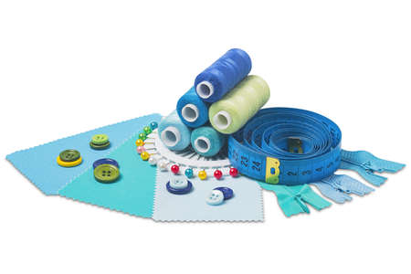 Sewing thread, needle, bobbins, buttons, zipper and fabric samples blue color on isolated white background