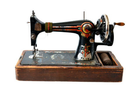 sewing machines: isolated antique sewing machine on white  Stock Photo