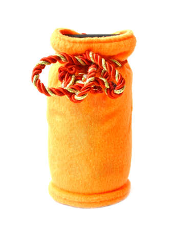 orange moneybox in the form of a bag on a white background photo