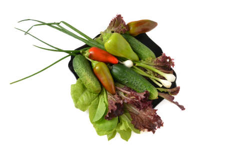 vegetables salad,cucumber, onion, pepper to rest upon plate on white background