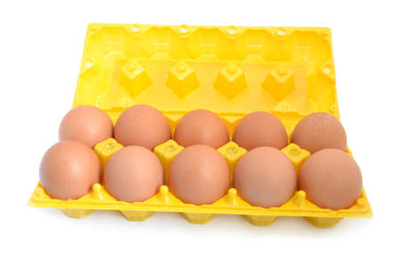 The yellow container for eggs on a white background photo