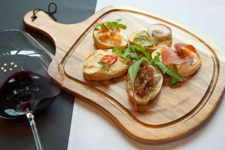 Italian bruschetta is with assorted fillings Stock Photo