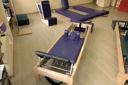 Reformer pilates studio machine for fitness workouts in gym. 写真素材