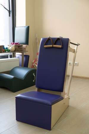 Yoga and pilates studio gym with training equipment for exercise, rehabilitation, physical therapy and workout. 写真素材