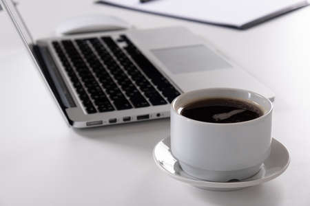 Laptop, notebook Tablet and cup of coffee on work desk