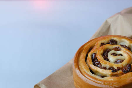 Sweet baked snail with raisins 写真素材