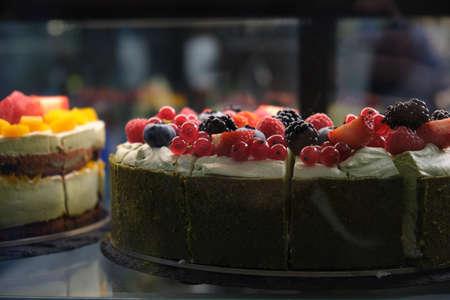 berry cake closeup in dark key