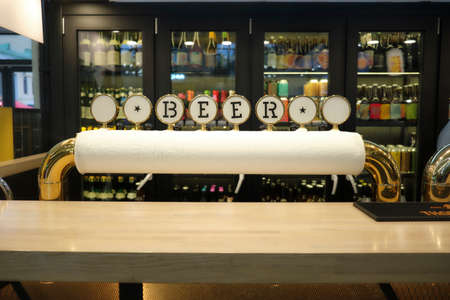 Icy beer tap on the background of a variety of beer showcases in the store close-up Stockfoto - 131752616