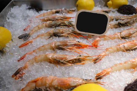 Fresh shrimp in a shop window in the ice 写真素材
