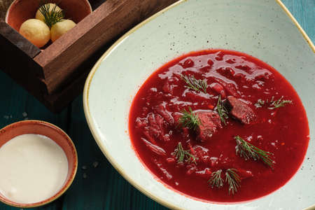 Red beet soup soup with cream,