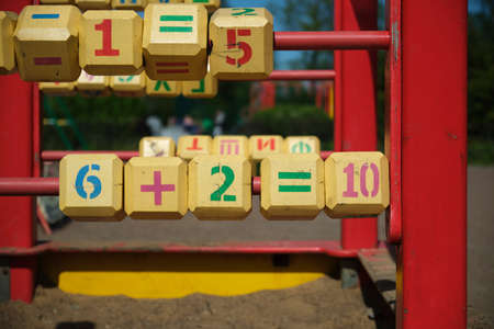 playground figures. Red color, numbers and signs. cubes.