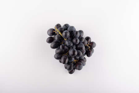 bunch of black grapes close-up on a white background Stockfoto