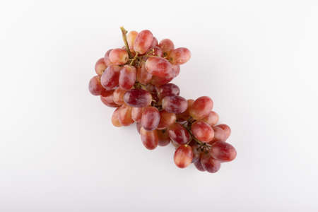bunch of red grapes close-up on a white background