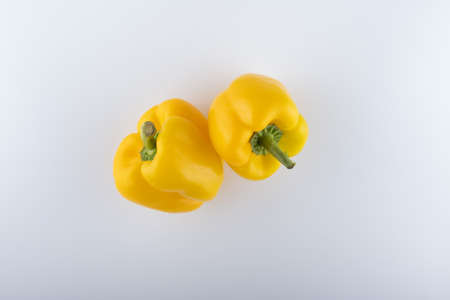 fresh yellow bell peppers close-up on a white background Stockfoto