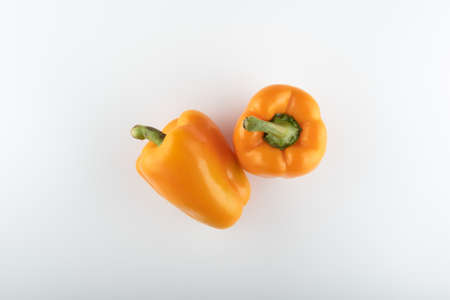 fresh orange bell peppers close-up on a white background Stockfoto