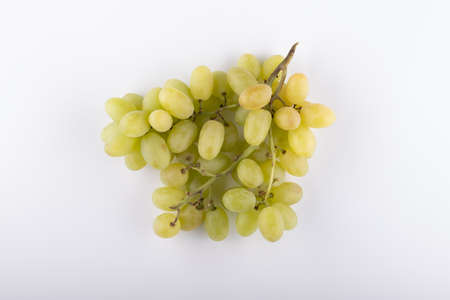 bunch of green grapes close-up on a white background