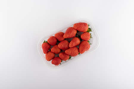 fresh strawberries in box isolated on white