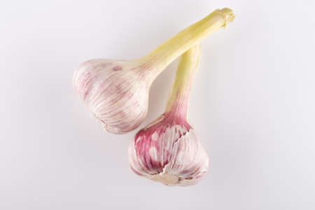 fresh heads of garlic close-up on a white background