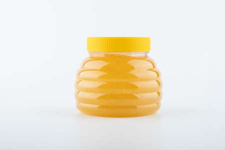 flower honey in large and small semolina on a white background close up