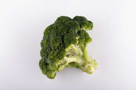 fresh broccoli close-up on a white background
