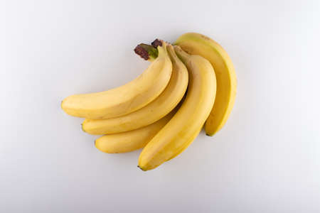 bunch of ripe bananas on a white background close-up