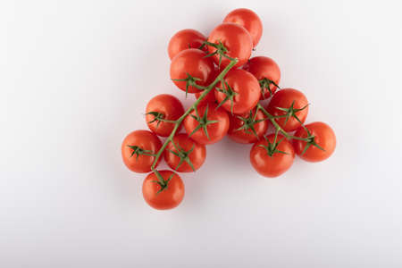 Ripe Fresh Cherry Tomatoes on Branch Isolated on White Background Stockfoto - 148666451