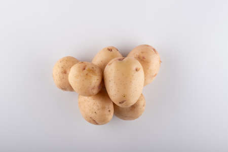 young white potatoes close-up on a white background Stockfoto - 148672150