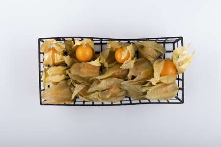 orange physalis berries in a box on a white background close-up Stockfoto