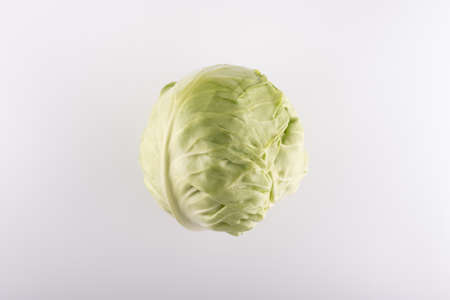 whole green cabbage swing closeup on a white background