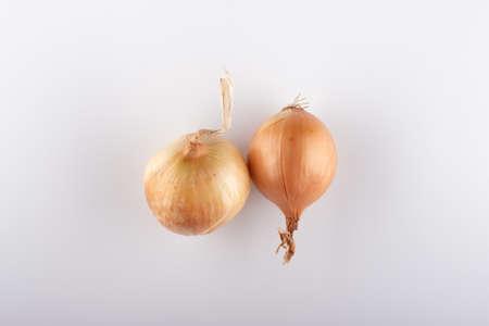 fresh white onion heads on a white background close-up Stockfoto - 149401836