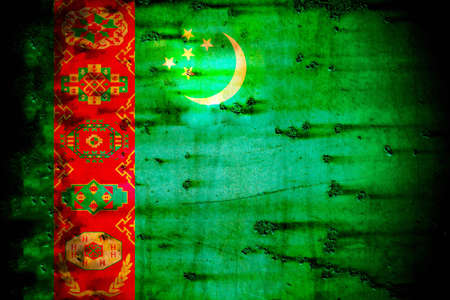 producing: The flag of Turkmenistan was adopted on January 24, 2001.The most detailed national flag in the world, it features a green field with a vertical red stripe near the hoist side, containing five carpet guls designs used in producing rugs stacked above two c Stock Photo