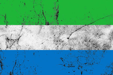defaced: The flag of Sierra Leone is a tricolour consisting of three horizontal green, white and blue bands. It was adopted in 1961, Sierra Leones independence year, to replace the British Blue Ensign defaced with the arms of the crown colony.